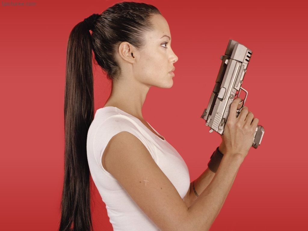 Angelina Jolie with a Gun Tomb Raider Wallpaper