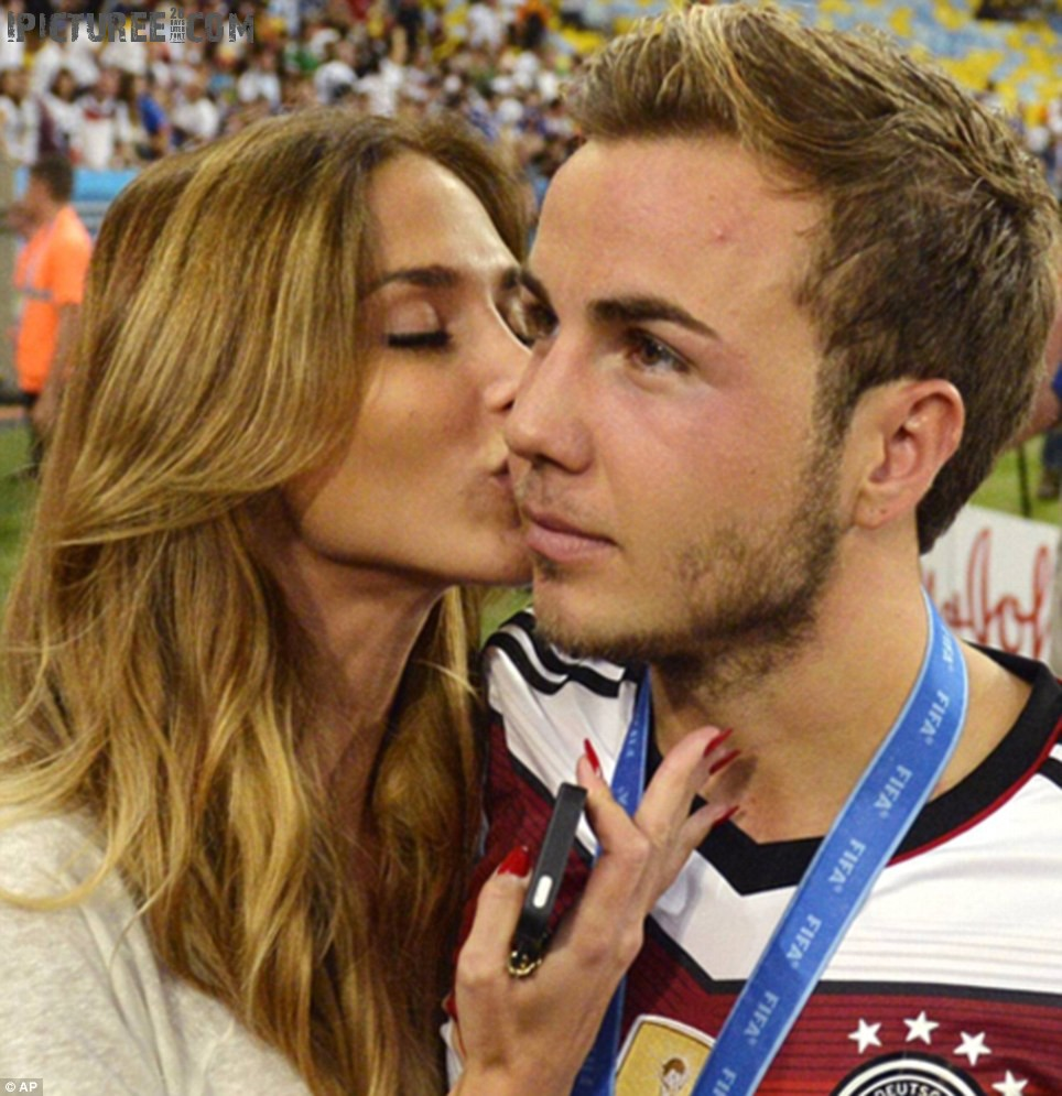 Mario Gotze being kissed by his Girlfriend at World Cup Final 2014
