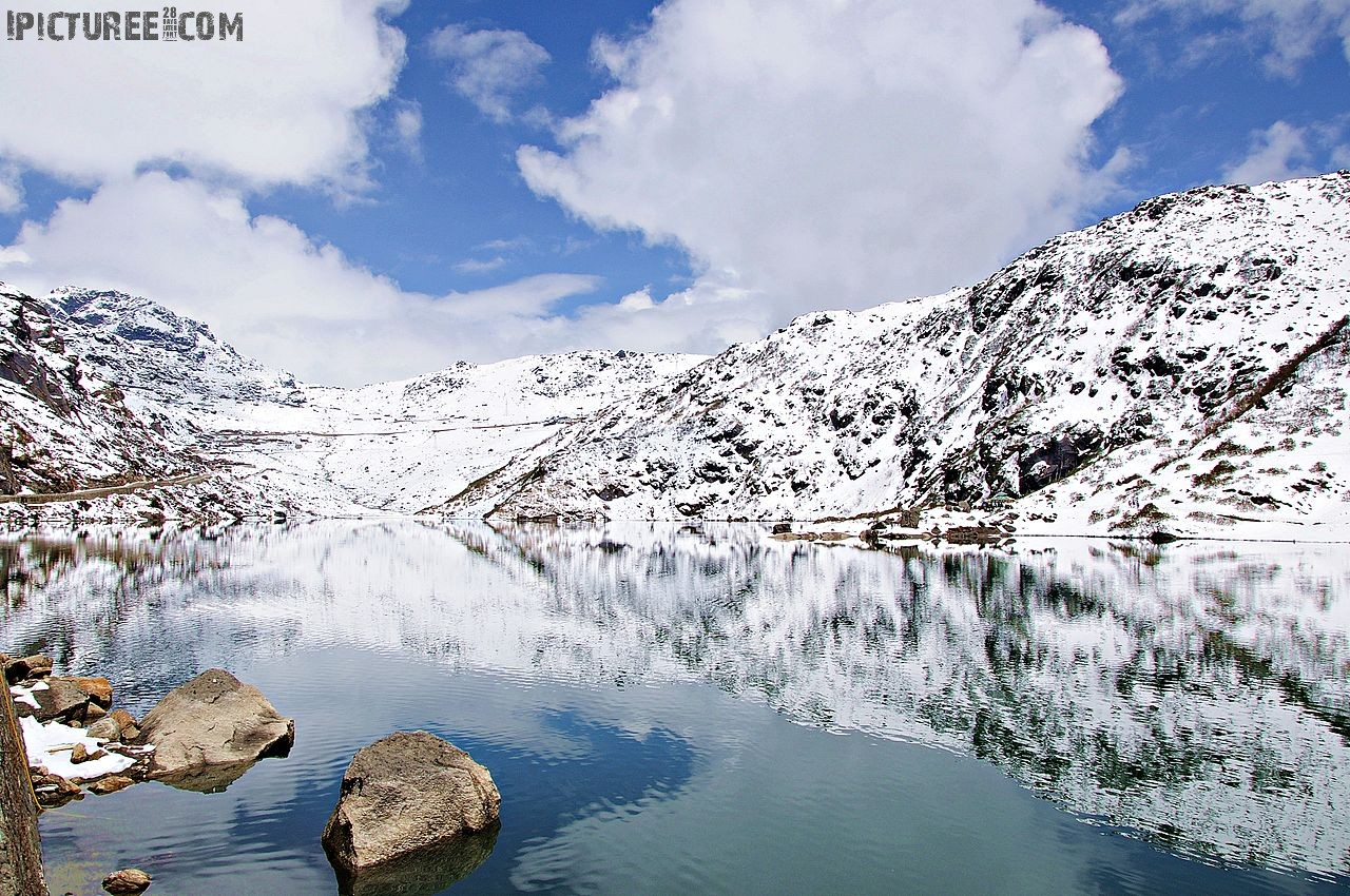 File:Reflection of snow covered mountains in Changu Lake.jpg